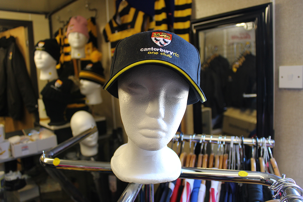 Adult baseball cap available from the club store