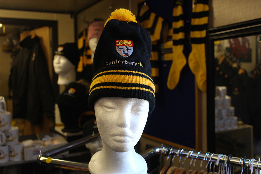 Branded bobble hat available from the club store