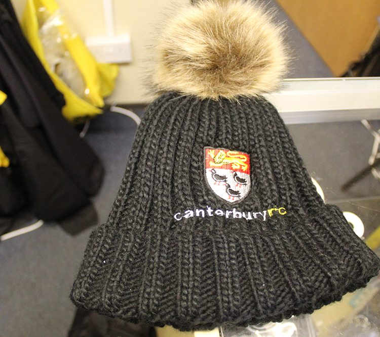 Ladies bobble hat available from the club store
