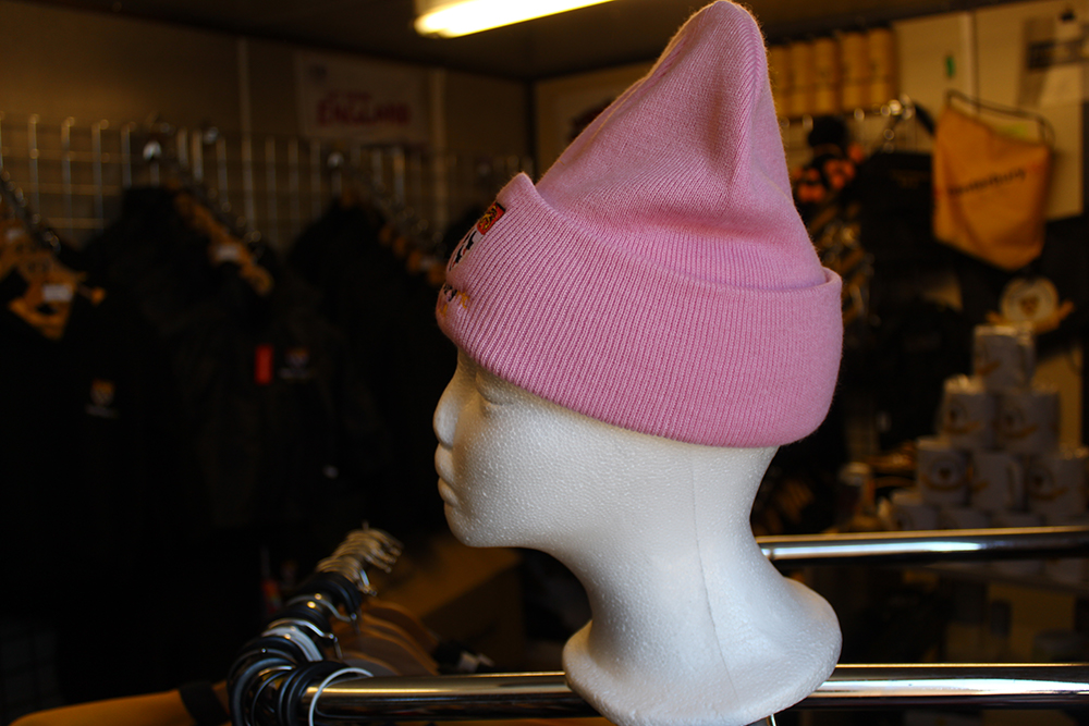 Girls pink beanie available from the club store